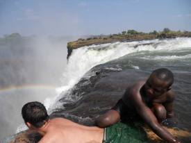 Taking a peek on the edge of the Falls during the Devils swim, Victoria Falls
