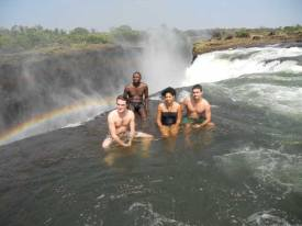 Feet in Devils Swimming Pool, sitting on the edge of the Victoria Falls