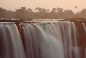 Beautiful shot of the falls during sunrise - Victoria Falls, Zimbabwe