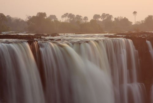 Beautiful shot of the falls during sunrise - Victoria Falls, Zimbabwe