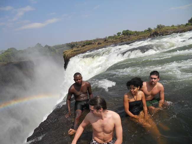 Swimming in the Devils Pool on the edge of the mighty Victoria Falls