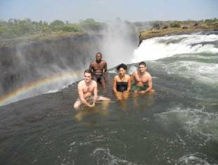 Swimming on the edge of the Falls in Devil's Pool - Victoria Falls