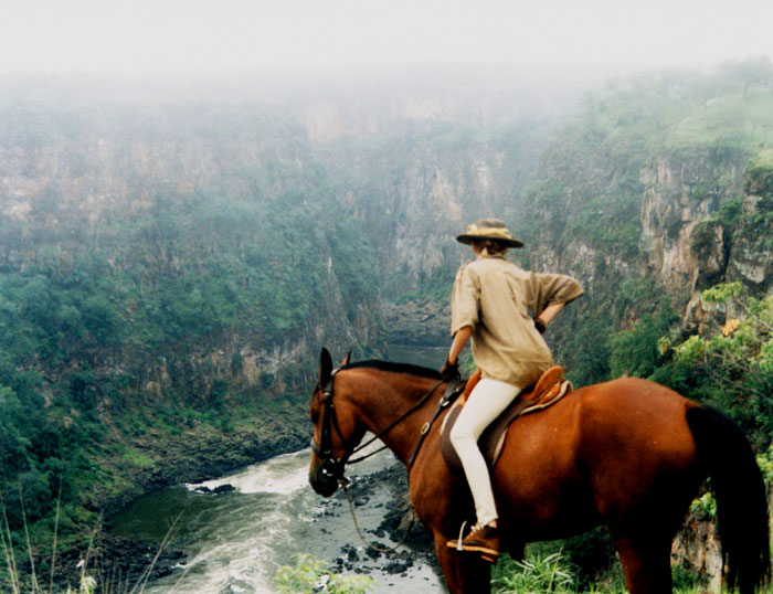 Alison on Horseback overlooking Batoka Gorge. Ultimate African Horse Safari   Ride through the African Bush