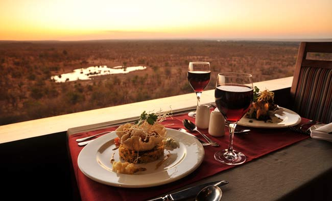 Sunset dining at Vic Falls Safari Lodge