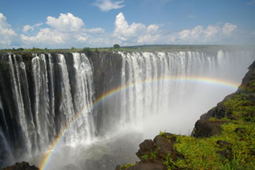 The Rainbow Falls section of the Victoria Falls - best rainbows are in the afternoon. Zimbabwe.