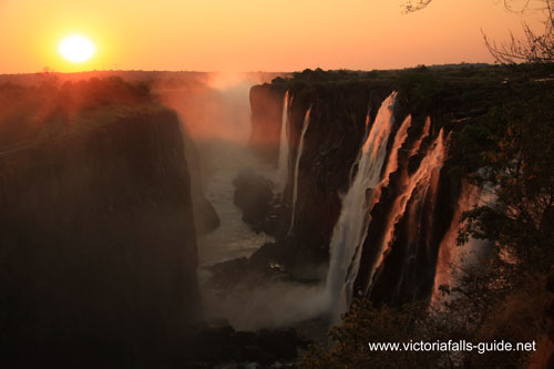 Shot of the sunset over the Victoria Falls from the Zambian side