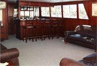 A comfortable lounge and bar area on the Catalina Houseboat - Kariba