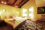 Inside an en-suite double room at Flat Dog Lodge - Victoria Falls accommodation, Zimbabwe