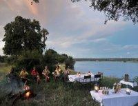 Relaxing on a canoe safari on the Zambezi River, upstream from the Victoria Falls, Zimbabwe