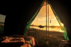 View from inside the tent - Overnight camping and canoe trips on the Zambezi River near Victoria Falls, Zimbabwe