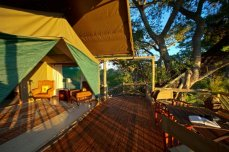 Outside deck of a private safari tent at Pom Pom Camp, Okavango Delta, Botswana