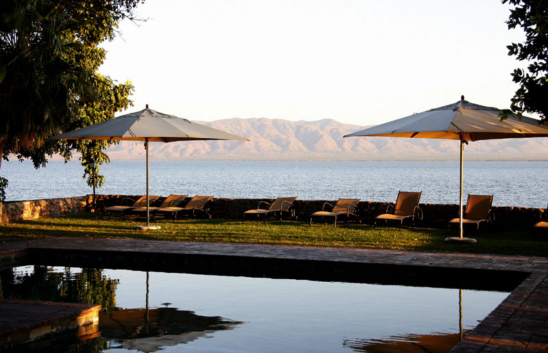 The pool at Spurwing Island Lodge with a view of Lake Kariba and the Matusadona Hills