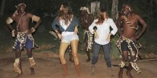 Traditional dancers at Gorges Lodge with guests joining in the fun - Victoria Falls, Zimbabwe
