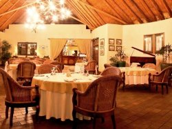 The Palm Restaurant dining room at Ilala Lodge, Victoria Falls