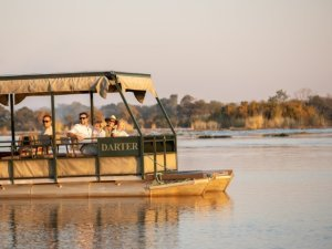 The Darter pontoon jetboat on a sunset cruise on the Zambezi River in Victoria Falls, Zimbabwe