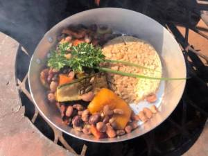 Traditional Zimbabwe food cooked on fire. Peanut butter rice, sugar beans, butternut, Dusty Road township experience in Victoria Falls, ZImbabwe