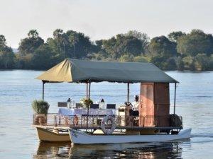 The small, 6-seater Kalunda boat on the Zambezi River in Victoria Falls, Zimbabwe