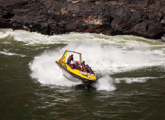 Zooting throught the Zambezi River rapids in a jet boat