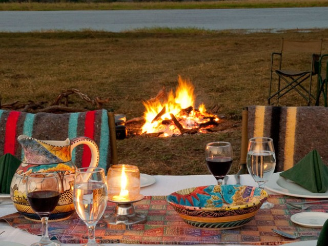A lovely bush dinner setting at Imbabala Zambezi Safari Lodge in Victoria Falls, Zimbabwe