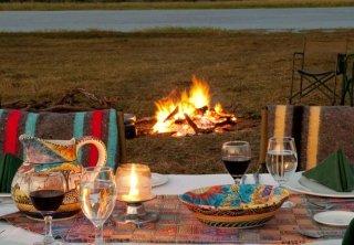 A lovely bush dinner setting at Imbabala Zambezi Safari Lodge in Victoria Falls, Zimbabwe