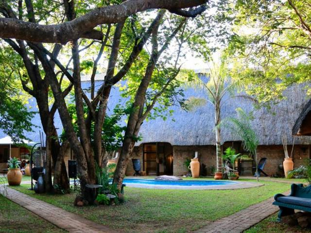 The quiet garden at Nguni Lodge in Victoria Falls, Zimbabwe