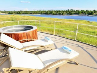 The Chobe Princess deck with views of the African bush in the background - Namibia, Botswana