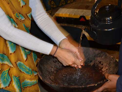Hand washing is done before meals. The Boma, Victoria Falls, Zimbabwe