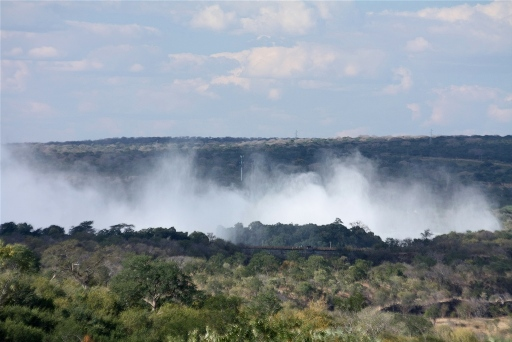 The spray for the Victoria Falls seen in the distance from the land for sale.