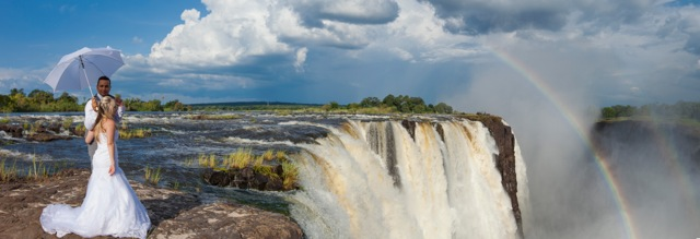 Newly wedded couple at the edge of the Victoria Falls