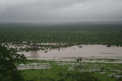 Sinamatella River in flood below camp. (Stephen & Sue Long)