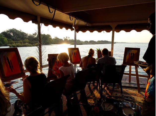 A river cruise painting workshop on the Zambezi River in Victoria Falls - Zimbabwe