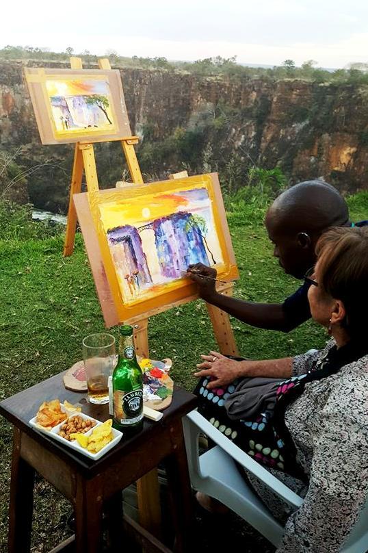 Painting on the edge of the Batoka Gorge with the Zambezi River below in Victoria Falls, Zimbabwe
