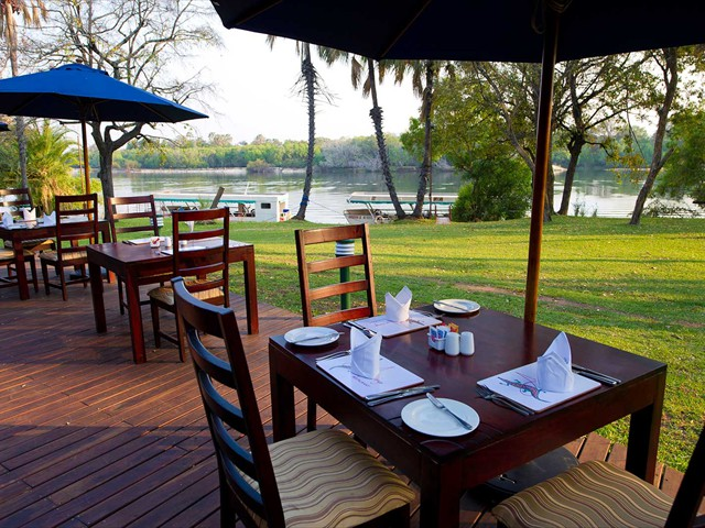 Beautiful garden dining with a view of the Zambezi at A'Zambezi River Lodge - Victoria Falls, Zimbabwe