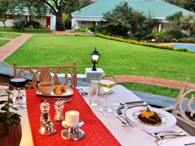 Awesome food, beautiful gardens and pool area of Batonka Guest Lodge, Victoria Falls Zimbabwe