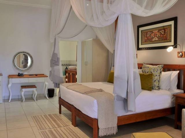 Batonka Guest Lodge room - get to stay in Victoria Falls, Zimbabwe, and save with this discounted package which includes flights.