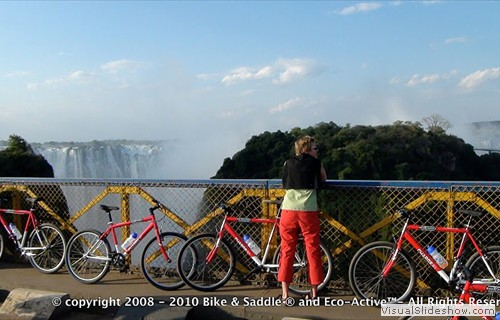 Bike tourist enjoying the view of the falls from the Victoria Falls Bridge