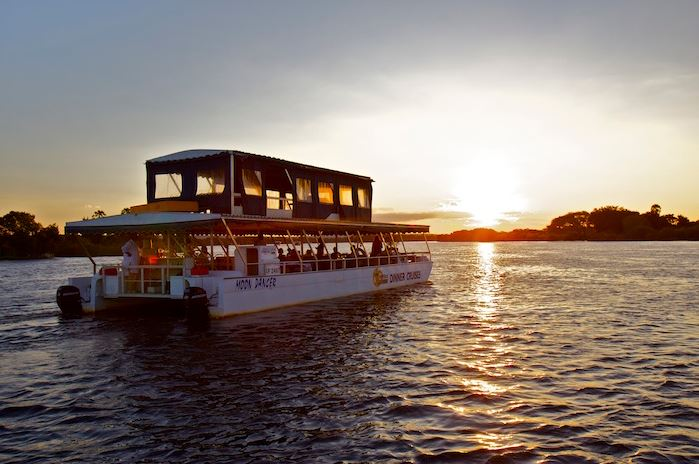 The Moondancer at sunset on the Zambezi River - dinner cruise in Victoria Falls, Zimbabwe
