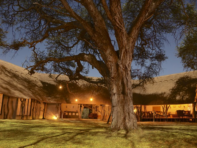 Well lit main lodge as seen in the evening