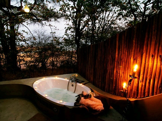 With outdoor bath and shower
