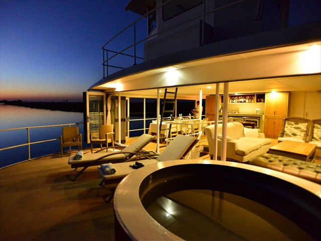 Take in the African sunset while in a jacuzzi in the Chobe wilderness - Chobe Princess between Botswana and Namibia