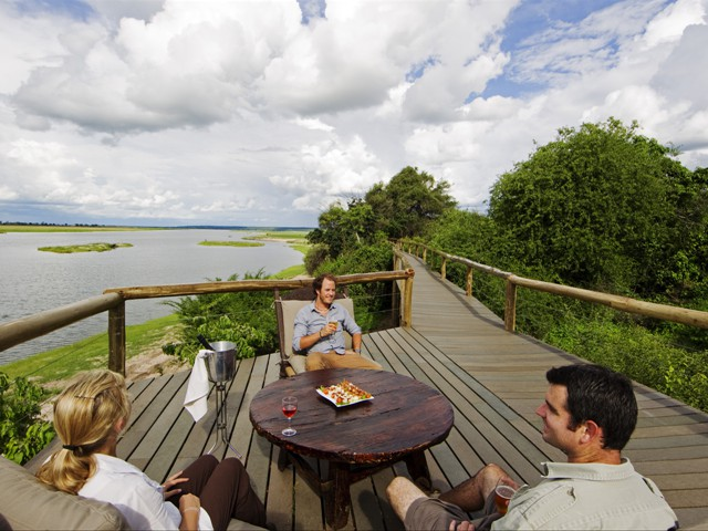 Guests on the viewing deck at Chobe Game Lodge, Chobe National Park, Botswana