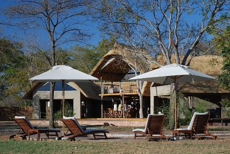 Guests in the bar at the main lodge at Elephant Camp - Hwange National Park