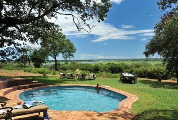 The pool at Imbabala Zambezi Safari Lodge with the Zambezi River in the background