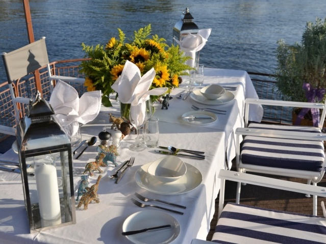Table is set on the Kalunda boat on the Zambezi River, Victoria Falls, Zimbabwe