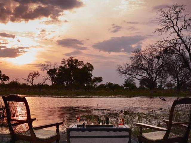 View of the waterhole over the dinner table at Elephant Valley Lodge - Chobe, Botswana