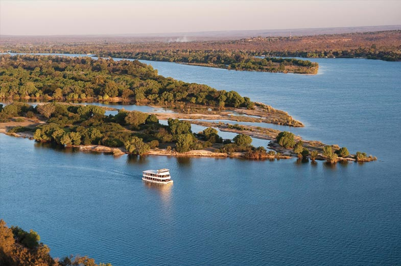 The African Queen vessel cruising the Zambezi River