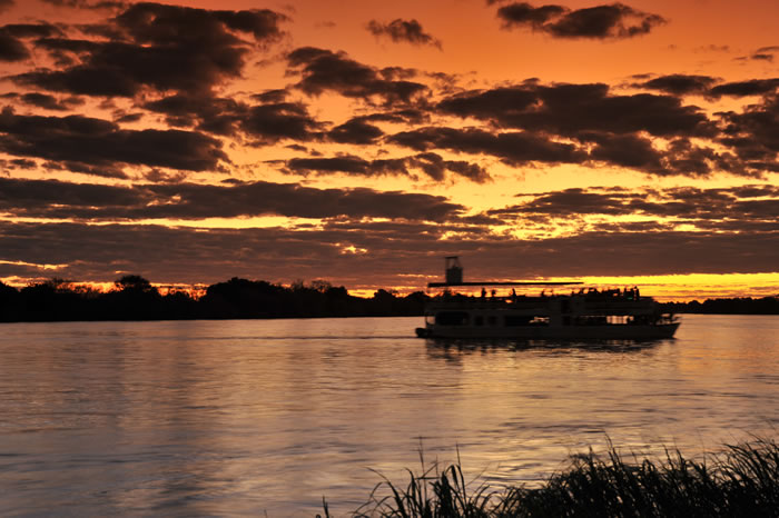 Sunset cruise on the Zambezi River near Victoria Falls