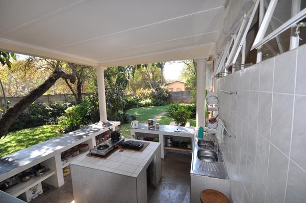 Self-catering kitchen next to loung area
