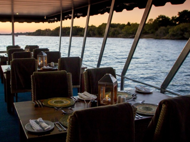 The table setting on the Malachite for the dinner cruise on the Zambezi River from Victoria Falls, Zimbabwe