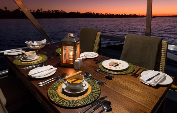 Dinner is set on the Malachite dinner cruise on the Zambezi River - Victoria Falls, Zimbabwe